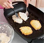 Potato Latkes Frying in a Pan