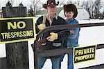 Couple with Shotgun Protecting Property