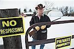 Man with Shotgun Protecting Property