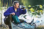 Man Drinking From Water Bottle on Kayak Trip