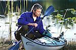 Man Packing Kayak