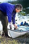 Man Adjusting Rope On Kayak