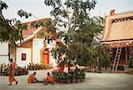 Buddhist Monks Repairing Roof and Building Sim Of Wat Choum Khong, Luang Prabang, Laos