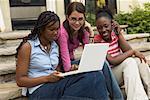 Teenagers Using Laptop Computer
