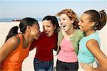 Four Women Friends On The Beach