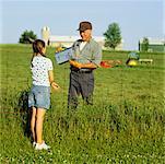 Girl Giving Farmer A Lunch Box
