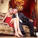 Man Kissing Woman on Sofa