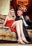 Man Flirting with Woman on Sofa