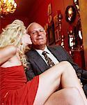 Woman Kissing Man on Sofa