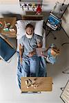 Nurse by Man in Hospital Bed
