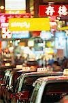 Taxi Cabs in City at Night, Kowloon, Hong Kong, China