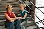 Women Talking, Sitting on Stairs