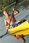 Homme kayak