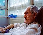 Elderly man in armchair