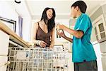 Woman and Boy Loading Dishwasher