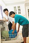 Man and Boy Loading Dishwasher