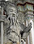 Stone Statue on Side Entrance of Wat Pho, Bangkok, Thailand