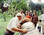 Grandparents Hugging Grandson