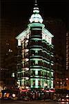 Low angle view of buildings illuminated at night, California, USA