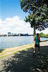 Man jogging on the bank of a river, Charles River, Longfellow Bridge, Boston, Massachusetts, USA
