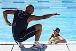 Coach Instructing Swimmer