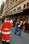Santa Waving at People on Sidewalk, New York City, New York, USA