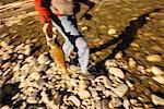 Man Carrying Fish