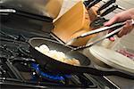 Close Up of Man Cooking Food
