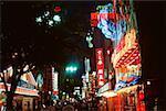 Buildings illuminated at night, Osaka, Japan