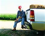 Farmer Sitting on Pickup Truck