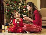 Girls Drinking Hot Chocolate At Christmas