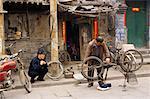 Man Fixing Bicycle, Pingyao, China