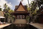 Man in Swimming Pool at Resort, Thailand