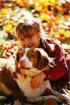 Portrait of Girl Hugging Dog