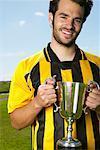 Portrait of Soccer Player Holding Trophy