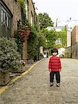 Portrait of Boy Standing In Street, Portobello, London, England
