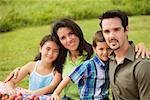 Portrait of parents with their children
