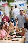 Woman Feeding man at Family Gathering