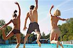 People Jumping in Swimming Pool
