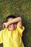 Portrait of Boy Lying on Grass