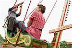 Couple Riding Swingboats, Carters Steam Fair, England