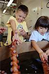 Children Touching Octopus at Aquarium