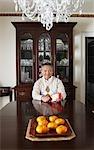 Portrait of Man in Elegant Dining Room