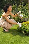 Woman Gardening in Formal Wear