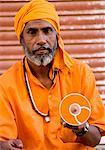Close-up of a mature man holding a cd, Pushkar, Rajasthan, India