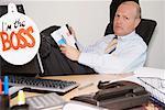 Portrait of Boss Reading Magazine at Desk