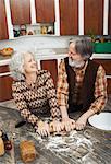Couple Making pâtisseries dans la cuisine