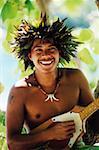 Close-up of a young man playing the ukulele, Hawaii, USA