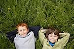 Portrait of Boys Lying Down in Field of Grass