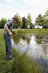 Boy Fishing in Pond